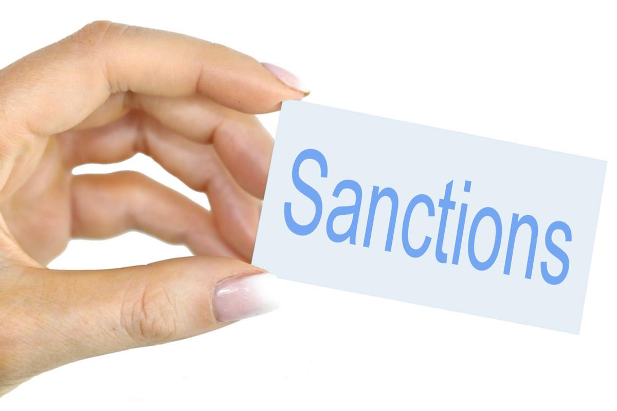 Sanctions - Free of Charge Creative Commons Hand held card image