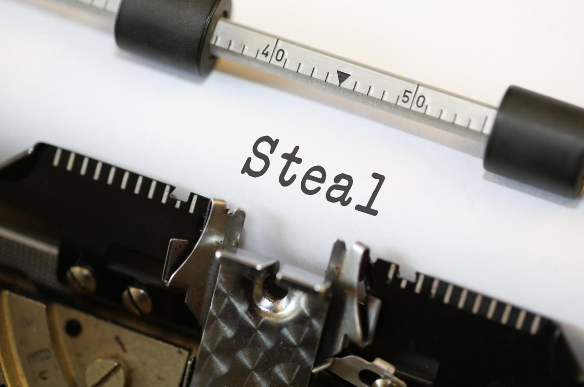 Typewriter typing the word steal